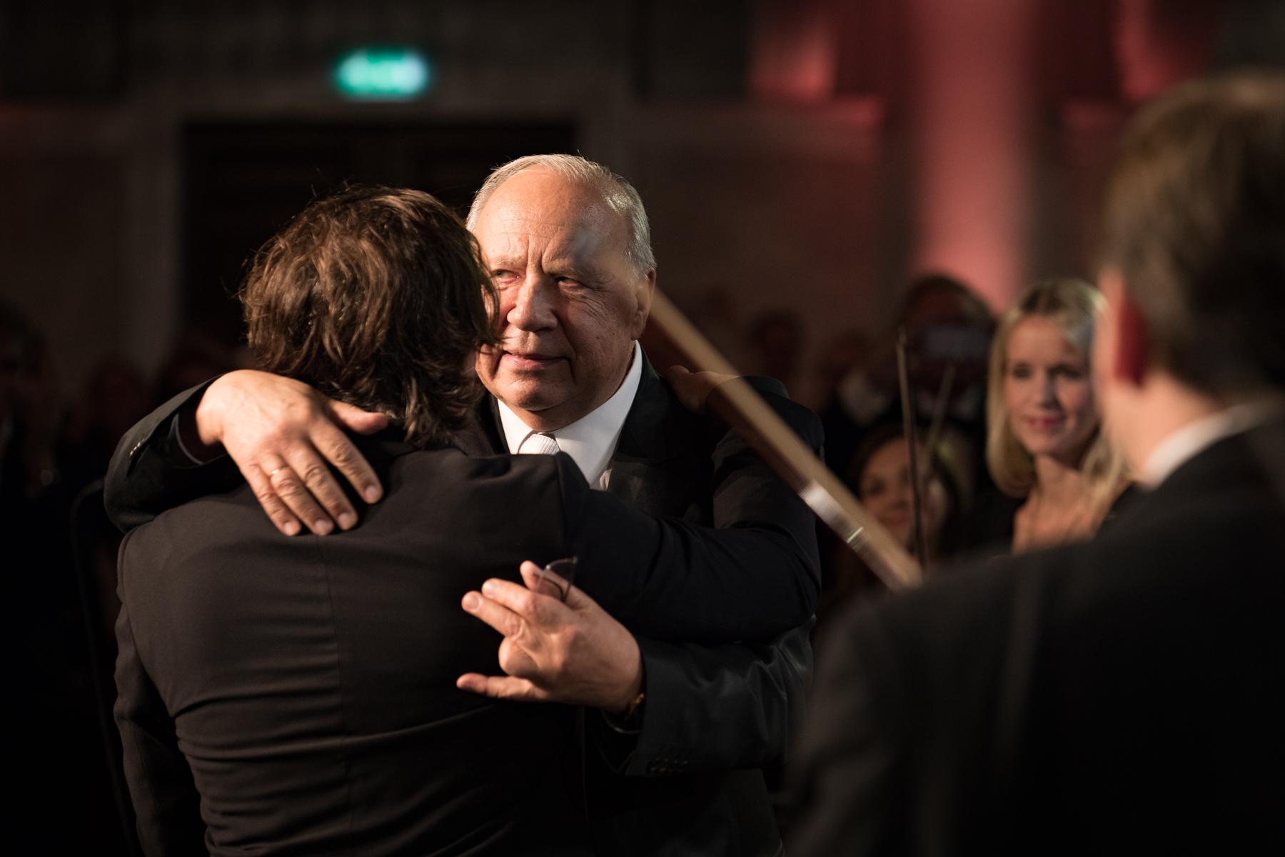 The Lifetime Achievement Award winner Neeme Järvi embraces his son, Kristjan
