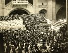 The nine-year-old Rattle can be seen here sitting in the front row of the audience (bottom right) for a performance of Mahler's Symphony No 8 by the RLPO, conducted by Charles Groves in Liverpool Cathedral