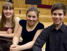 The three finalists - flautist Emma Halnan, pianist Lara Ömeroğlu and violinist