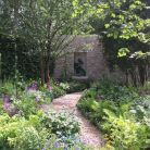 Designed in three distinct sections, the garden features verdant woodland, a terrace of perennials and an oak and limestone pavilion (eleventenths).