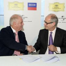 Daniel Barenboim shakes hands with Universal chief operating officer Max Hole