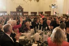 Dame Kiri Te Kanawa holds her Lifetime Achievement Award aloft to cheers from the audience