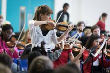 Nicola Benedetti performing with six schools from across London at the inaugural Music in Secondary Schools Trust concert earlier this month (photo Benjamin Ealovega)