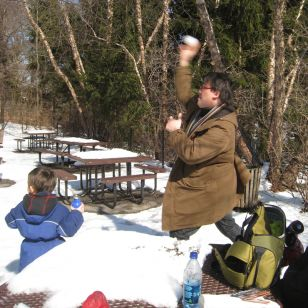 Alan Gilbert practices his snowball-throwing technique at the Bronx Zoo (photo:
